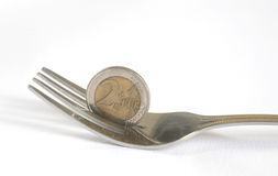 Money euro cents and dining fork to eat Royalty Free Stock Image