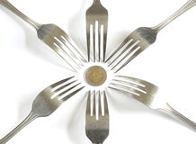 Money euro cents and dining fork to eat Stock Photos