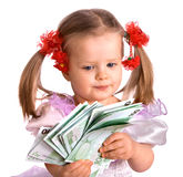 Money euro and child girl in dress. Stock Photos