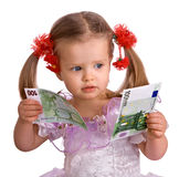 Money euro  and child  girl in dress. Royalty Free Stock Images