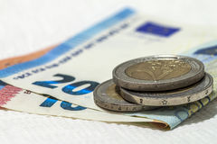 Money euro coins and banknotes stacked on each other in differen Stock Image