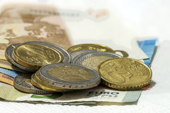 Money euro coins and banknotes stacked on each other in differen Stock Photo