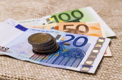 Money euro coins and banknotes stacked on each other in differen Stock Photography