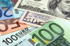 Money: euro and dollar banknotes Stock Image