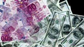 Money from euro and dollar bills Stock Photos