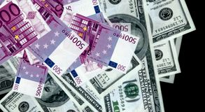 Money from euro and dollar bills Stock Photo