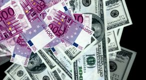 Money from euro and dollar bills Stock Images