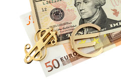 The money euro and dollars and golden sign stock photo
