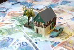 Money of euro and house. Money of euro for purchase of the private house and car Royalty Free Stock Photos