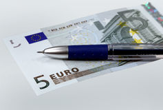 Money euro and pen Royalty Free Stock Photography