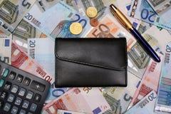 Money euro. Wallet calculator pen Royalty Free Stock Image