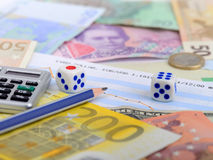 Money European currency dice roulette calculator Stock Photo