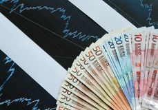 Money euros with graph. Bills Royalty Free Stock Images