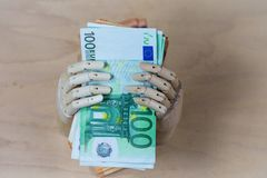 Money , euros in a hand, on wooden background Stock Photography
