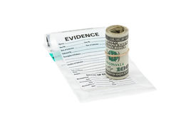 Money evidence. Roll of dollar bills on evidence bag royalty free stock photo