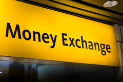 Money exchange / currency exchange sign board at airport Stock Photos