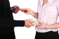 Money in exchange for documents. On white stock photography