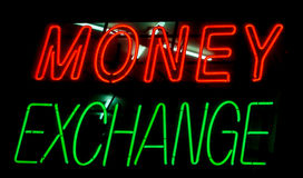 Money Exchange. Neon currency sign royalty free stock photo