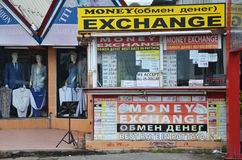 Money exchange shop on the corner of a street in Pattaya Stock Images