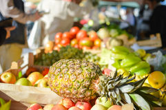 Money exchanging hands at a fruit market stall Stock Photo