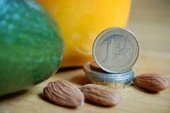 Money and exotic fruits Stock Photo
