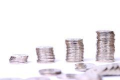 Money expanding. Stacks of coins isolated on white background Royalty Free Stock Photos