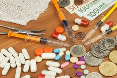 Money for expensive treatment. The Swiss franc and the euro on drugs. Selling drugs. Expensive health care. Modern medicine. Stock Photos