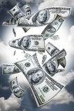 Money falling. One hundred and fifty dollar bills falling from the sky Cash falling from sky stock images