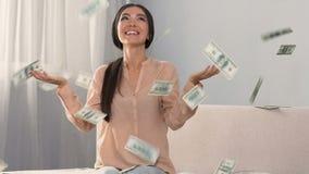 Money falling on happy shopaholic woman enjoying cash back service, slow motion. Stock footage stock video