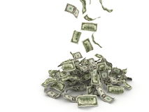 Money falling on pile. US 100 dollar bills falling. White background Royalty Free Stock Photography