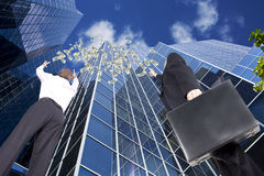 Money falling from the sky. Business people reaching for money falling from the sky Stock Photography