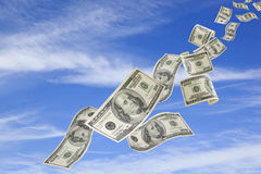 Money Falling from Sky. US one hundred dollar bills falling from a blue sky Royalty Free Stock Image