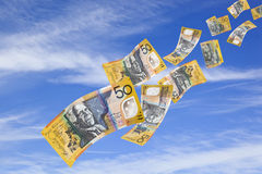 Money Falling from Sky. Australian fifty dollar bills falling from a blue sky Stock Photography