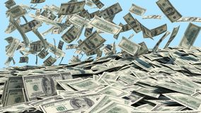 Money falling from the sky in a heap Stock Image