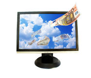 Money falling from sky in monitor. Money falling from blue sky in lcd monitor royalty free stock images