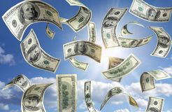 Money falling from the sky. And some clouds stock photo