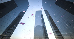 Money falling from skyscrapers Stock Photo