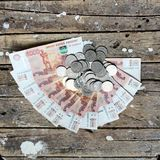 Money fan. A big pile of money on the wooden floor Royalty Free Stock Photography