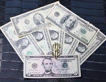 Money fan. Black background. Dollars light clip bottom black background Stock Photo