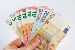 Money fan in a hand. Bank notes widespread in a hand Royalty Free Stock Photo