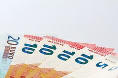 Money fan from the side. Bank notes widespread on white ground Stock Photography