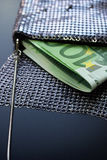 Money in Fancy Evening Bag. Two hundred Euro bills in a fancy evening bag, vertical view Stock Photography