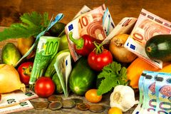 Money for farmers. Subsidies for agriculture. Financing of vegetable growing. Valid Euro banknotes and coins. Sale of vegetables. Money for farmers. Subsidies royalty free stock photos