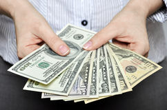 Money in female hands. Closeup, sallow DOF stock photography