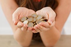 Money, finance. Girl with heap of coins Royalty Free Stock Images