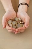 Money, finance. Girl with heap of coins Royalty Free Stock Photos