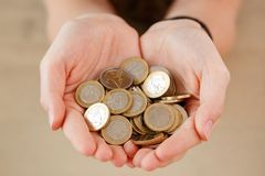 Money, finance. Girl with heap of coins Royalty Free Stock Photography