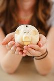 Money, finance. Girl with piggy Stock Photography