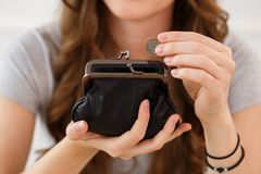 Money, finance. Girl with wallet Stock Photos