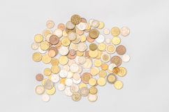 Money and Finance Topic: cash coins are isolated on a white background in the studio a top view Stock Images
